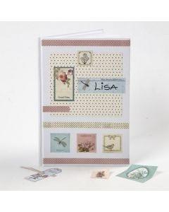 Decoupage Sticker und Design Papier als Cover eines Notizbuches