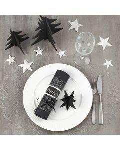 Der Weihnachtstisch, dekoriert in Schwarz und Silber