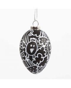 Kritzel-Malerei auf einem schwarzen Ei