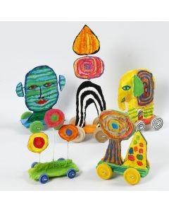 Kunstfiguren aus recycelter Wellpappe und Mullbinden