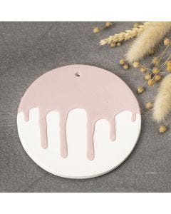 A decorative plate from self-hardening clay with a glazed effect