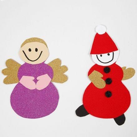 Engel und Kobold, angefertigt mit einer Schablone aus einem unserer Weihnachts-Deko-Sets