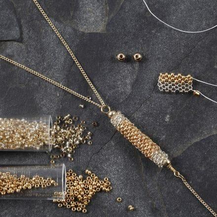 Röhrenförmiger Schmuckanhänger aus Rocaille-Perlen