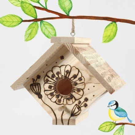 A bird box decorated with a pyrography tool
