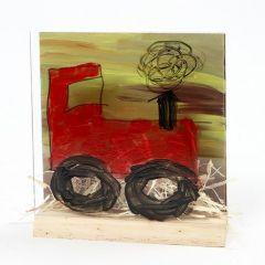 Ein Landschaftsbild mit Traktor in einem 3D-Rahmen
