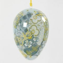 Ein transparentes Ei mit Decoupage-Verzierung