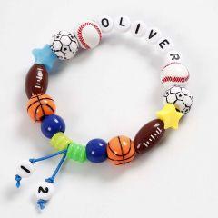 Armband aus verschiedenen Perlenarten und farbiger, elastischer Schmuckkordel