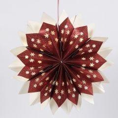 Ein Stern aus Glitzerpapier-Tüten, beleuchtet mit LED Lämpchen