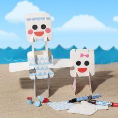Grafische Figuren aus Karton, verziert mit Plus Color-Markern und Stempeln