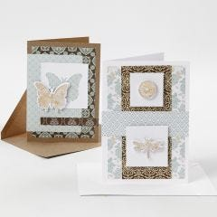 Grußkarten, verziert mit Design-Papier, Stanzmotiven und Dekorfolie
