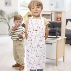 Kinderschürze mit gestempeltem Namen und Kirschen-Design