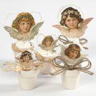 Gestanzte Engelköpfe im Vintage-Look mit kleinen Blumentöpfen als Standfuß