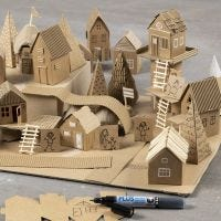 Bauen Sie eine Miniatur-Stadt aus recyceltem Material und Karton