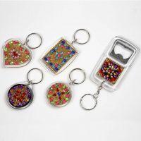 Schlüsselanhänger und Flaschenöffner mit Strasssteinen