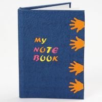 Notizbuch mit ausgestanzten Motiven