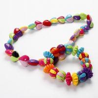 Armband und Halskette mit zweigeteilten Perlen
