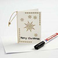 Eine Weihnachtskarte mit goldenen Stickern