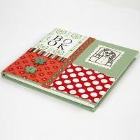 Ein Notizbuch bedeckt mit einer Collage aus Bio-Baumwolle