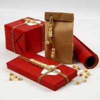 Geschenkverpackung mit Botschaft aus Buchstabenperlen