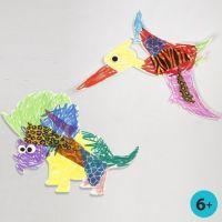 Bemalte und dekorierte Dinosaurier aus weißem Karton