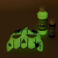 Maske, bemalt mit fluoreszierender Farbe