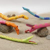 Tiere aus Holzstöcken, bemalt mit Plus Color-Markern