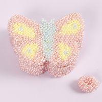 Box in Schmetterlings-Form, verziert mit Pearl Clay