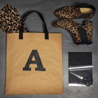 Tüte/Tasche aus Kunstlederpapier, verziert mit Bügelfolie