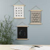 Wandbilder aus Kunstlederpapier mit eingebrannten Mustern
