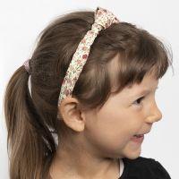 Haarband, verziert mit Stoffknoten