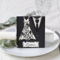 A menu card for a wedding  decorated with a dress and dinner jacket