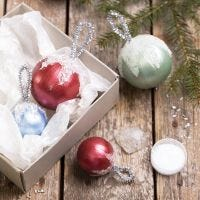 Christmas baubles decorated with Art Metal paint and artificial snow