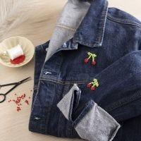 Perlenstickerei auf einer alten Jeansjacke